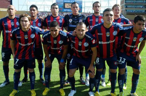 Players of the Argentine soccer club San Lorenzo de Almagro pose with a jersey showing an image of Pope Francis in Santa Fe
